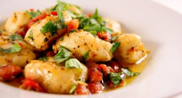 Gnocchi with Pancetta dressed in Garlic, Red Chill and Basil Butter
